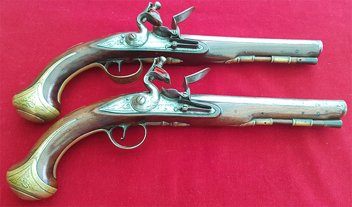 Image of two pistols